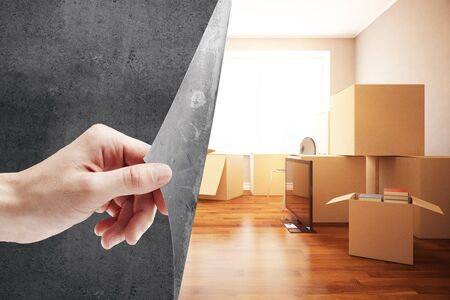 condo: Girls hand flipping abstract concrete page, revealing new room with moving boxes. Repairs concept. 3D Rendering Stock Photo