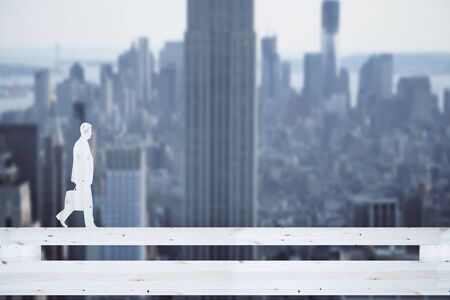 Side view of wooden businessman silhouette walking on abstract bridge. City background. Balancing concept