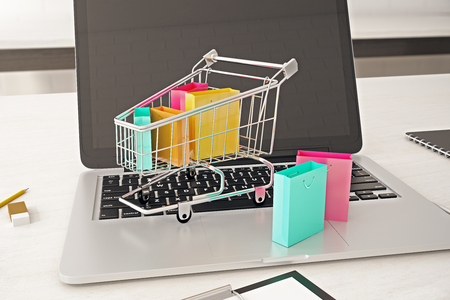 front view: Front view of empty laptop computer screen with cart and colorful bags. Buying online concept. Mock up, 3D Rendering