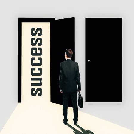 text room: Back view of young man in abstract interior looking at open opportunity door. Success concept. 3D Rendering