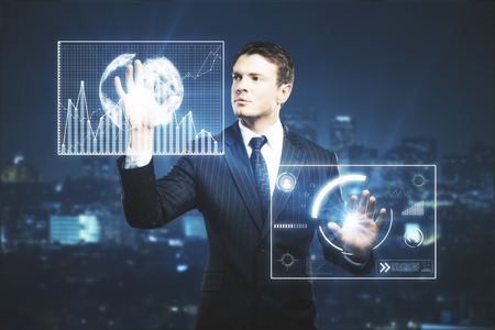 modern innovative: Businessman pressing abstract glowing business screen projections on nigth city background. Future concept