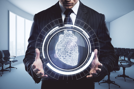 Businessman holding abstract digital circle with polygonal heart in interior. Health concept. 3D Rendering