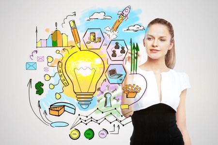 lamp light: Portrait of beautiful european businesswoman drawing creative business sketch on light background. Progress concept