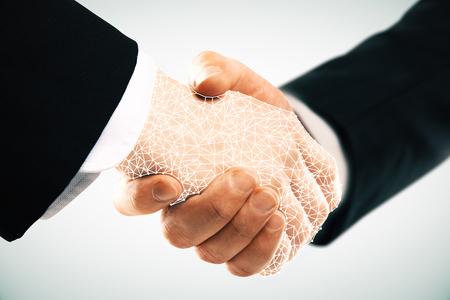 Abstract polygonal handshake on light background. Teamwork concept Stock Photo