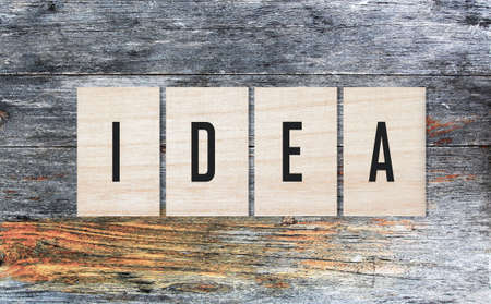 innovate: Wooden squares with text on aged background. Idea concept. 3D Rendering Stock Photo