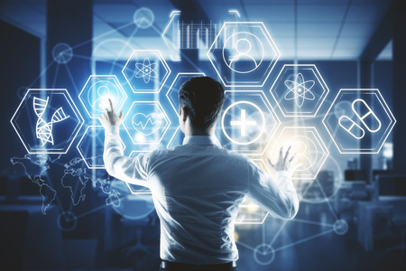 Back view of young businessman pressing digital medical buttons on blurry interior background. Touchscreen concept. Double exposure Imagens