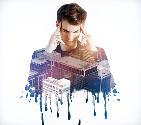 Abstract portrait of thinking young businessman on city background. Brainstorming concept. Double exposure Stock Photo