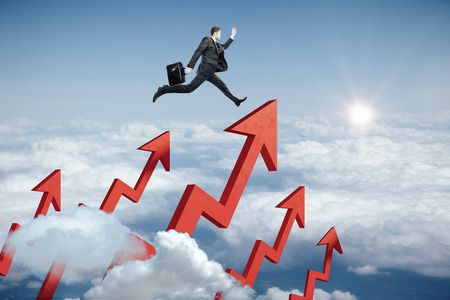 creative: Side view of young businessman running on red chart arrows in blue sky. Sales concept. 3D Rendering