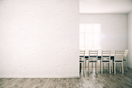 Front view of minimalistic white brick conference room with empty wall and wooden floor. Mock up, 3D Rendering Stock Photo