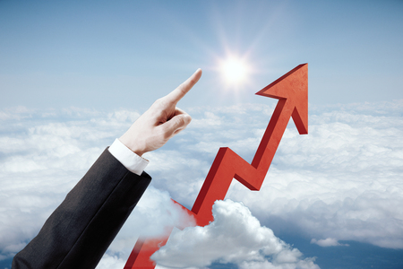 Businessmans hand and arrow pointed at blue sky with sunlight. Success concept. 3D Rendering Stock Photo