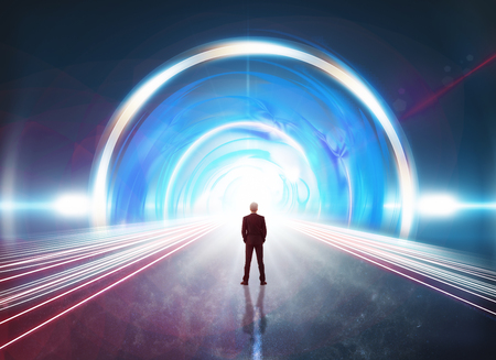Back view of man standing in front of glowing futuristic tunnel. 3D Rendering