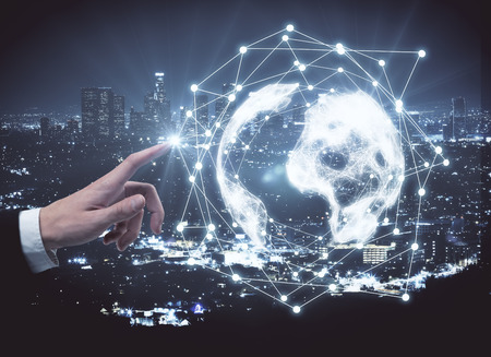 Businessman pointing at abstract digital globe on illuminated night city background. Global network and communication concept. 3D Rendering