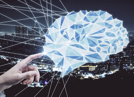 smart man: Hand pointing at abstract polygonal brain on night city background. Brainstorm concept. 3D Rendering