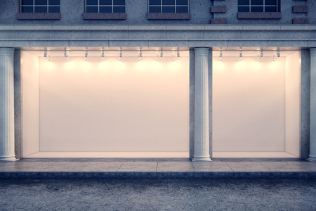 rendering: Front view of building with illuminated clear storefront and columns in night city. Advertisement and commerce concept. Mock up, 3D Rendering