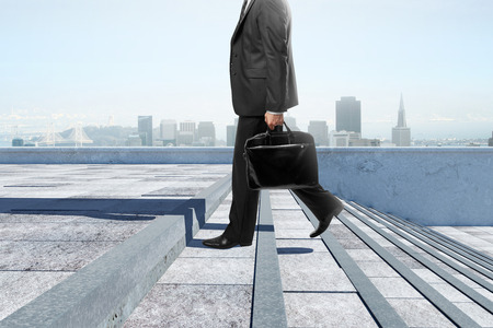 business people: Side view of young businessman with briefcase climbing stairs in city. Success and growth concept. 3D Rendering