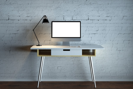 table top: Interior with empty computer and table lamp on desk, white brick wall and wooden floor. Mock up, 3D Rendering