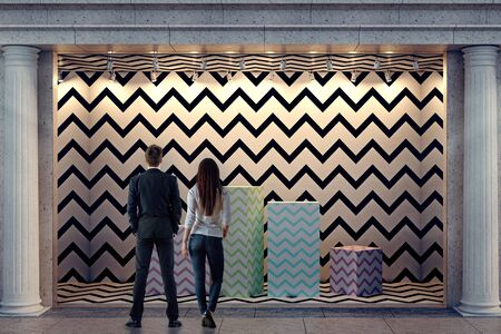 display: Back view of young man and woman looking at storefront with empty colorful podiums for sample products at night. Exhibition and retail concept. Mock up, 3D Rendering