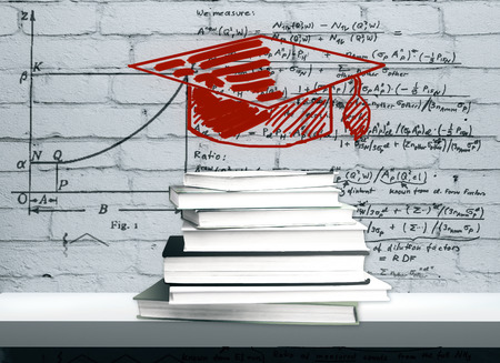 Drawn graduation cap and book pile placed on white shelf with mathematical formulas on brick wall in the background. Knowledge and science concept