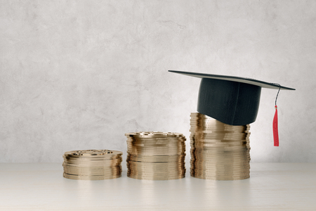 Abstract golden coins with graduation cap on concrete background. Education and financial growth concept. 3D Rendering
