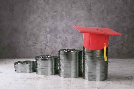 silver coins: Abstract silver coins with red graduation cap on concrete background. Education and income concept. 3D Rendering