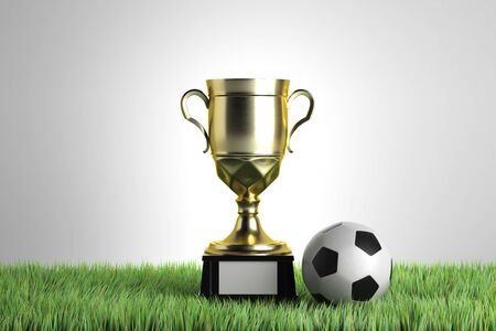 Golden winners cup with football placed on grass. Gray background. Leadership concept. 3D Rendering