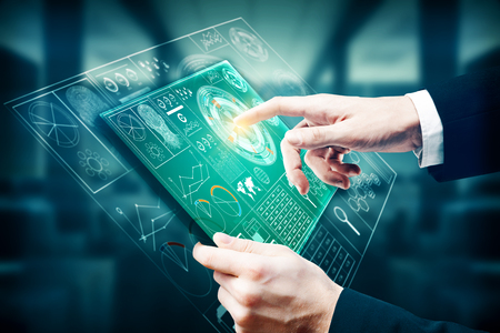 Businessman using tablet with digital business hologram on blurry office interior background. Technology and future concept. 3D Rendering
