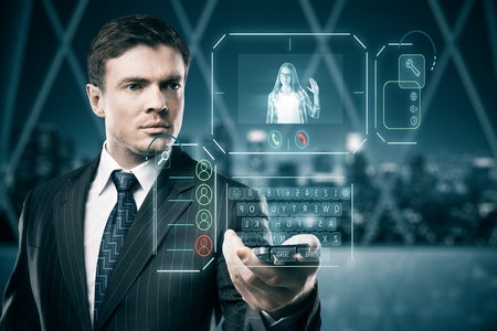 Man in blurry interior communicating with young woman waving at him through abstract futuristic screen hologram. Concept of network, communication, family, technology, augmented reality and future. 3D Rendering photo
