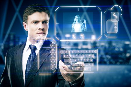 Businessman in blurry interior communicating with young woman waving at him through abstract futuristic screen hologram. Concept of network, communication, family, technology, augmented reality and future. 3D Rendering photo