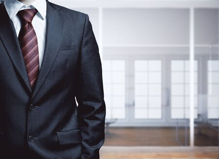 ceo: Businessman in blurry office room interior. Work concept Stock Photo