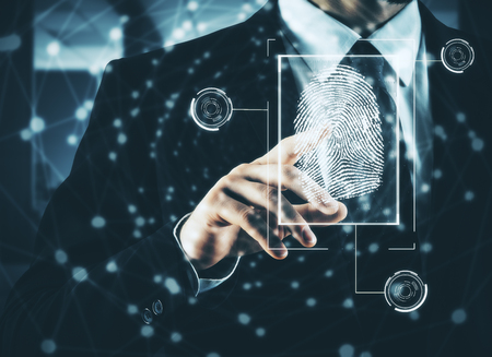 Businessman pressing abstract fingerprint interface on blurry background. Identification concept. Double exposure Archivio Fotografico