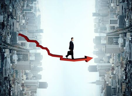 Man with red chart arrow on abstract city background. Success concept