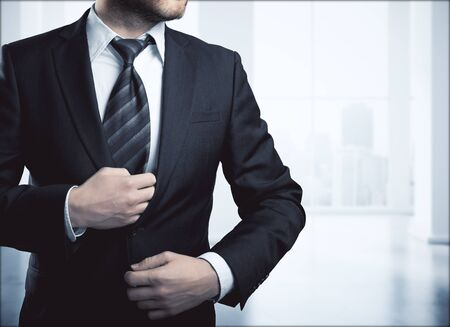 ceo: Businessman in blurry office room interior. Job concept Stock Photo