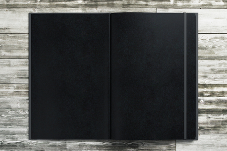 Blank black notepad on wooden desktop. Advertisement, supplies, education, text, copy space concept. Mock up, 3D Rendering