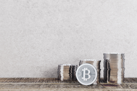 electronic commerce: Silver bitcoin piles in interior with concrete wall and wooden floor. Money concept. 3D Rendering