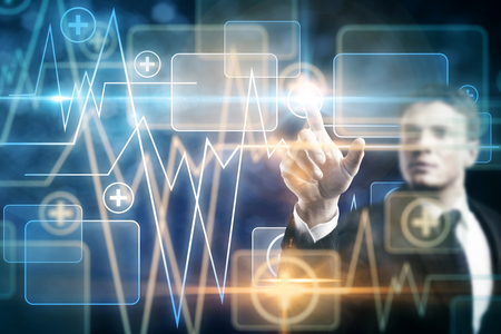 Blurry businessman pressing buttons on blue tech medical screen with heartbeat. Technology, medicine, innovation, interface and future concept. Double exposure photo