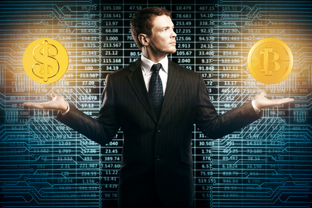 Businessman with glowing dollar and bit coins in hands on abstract circuit background. E-business and choice concept photo