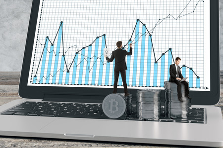 Abstract image of businessmen drawing business chart on laptop screen with silver bitcoin piles on keyboard. Cryptocurrency, teamwork and trade concept. 3D Rendering photo