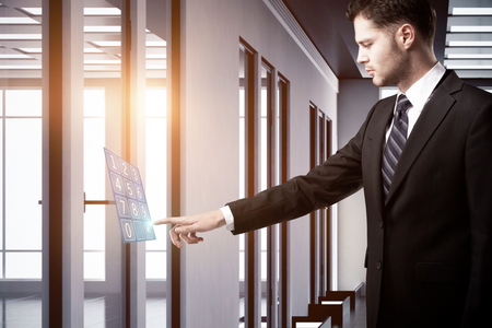 Businessman using digital dial hologram in modern office. Innovation concept. 3D Rendering photo