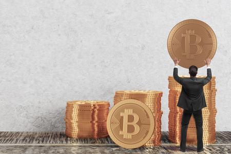 Businessman holding golden bitcoin in clean interior. E-commerce concept. 3D Rendering photo