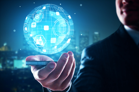 Businessman holding mobile phone with business globe projection on blurry night city background. Global business concept. 3D Rendering photo