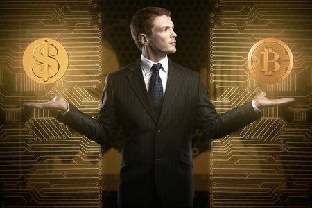 Businessman with glowing dollar and bit coins in hands on abstract circuit background. Cryptocurrency and choice concept photo