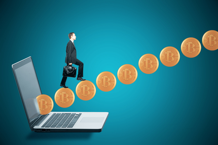 Side view of young businessman climbing abstract bitcoin ladder on blue laptop background. Cryptocurrency concept. 3D Rendering 写真素材