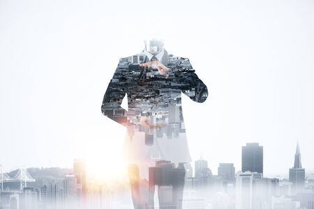 Abstract image of businessman holding copy space on creative city background. Creativity concept. Double exposure