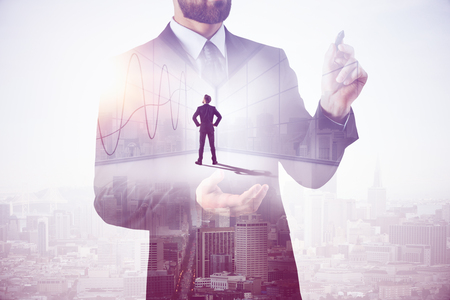 Businessman drawing business chart on bright city background. Finance concept. Double exposure  Stock Photo