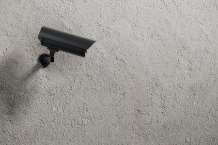 security monitor: Black CCTV camera on concrete wall background with copyspace. Watch concept. 3D Rendering Stock Photo