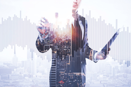 Businessman with document in hand drawing abstract business chart bars on bright city background. Trade concept. Double exposure 스톡 콘텐츠