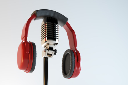 Red headphones and retro mic on light background. Audio concept. 3D Rendering