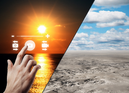 Hand using abstract digital camera interface on beautiful landscape backgrounds. Photo concept