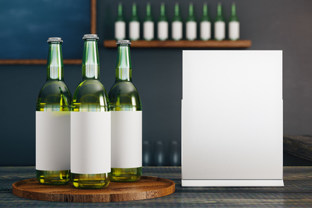 Close up of glass beer bottles with empty label and poster placed on wooden pub counter. Blurry background. Drink concept. Mock up, 3D Rendering Stock Photo