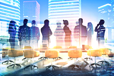 Abstract silhouettes of businesspeople in conference room with city view. Communication concept. Double exposure